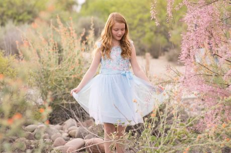 Girl in blue tulle dress in desert by Jubilee Family Photography.