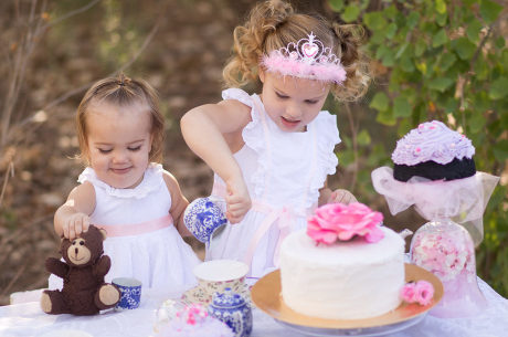 Little girls having a tea party photographed by Jubilee Family Photography in Gilbert, AZ.
